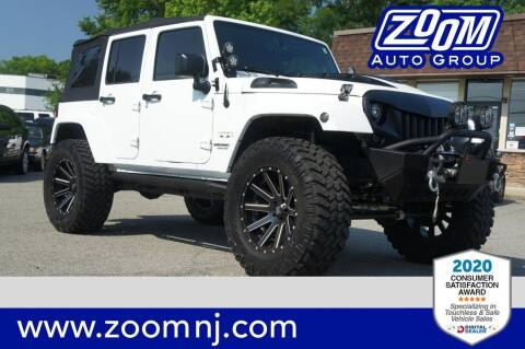 2016 Jeep Wrangler Unlimited for sale at Zoom Auto Group in Parsippany NJ