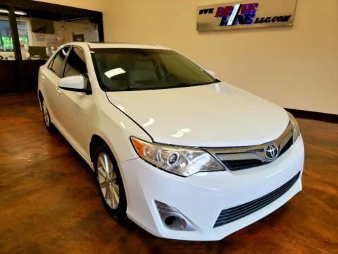 2012 Toyota Camry for sale at Driveline LLC in Jacksonville FL