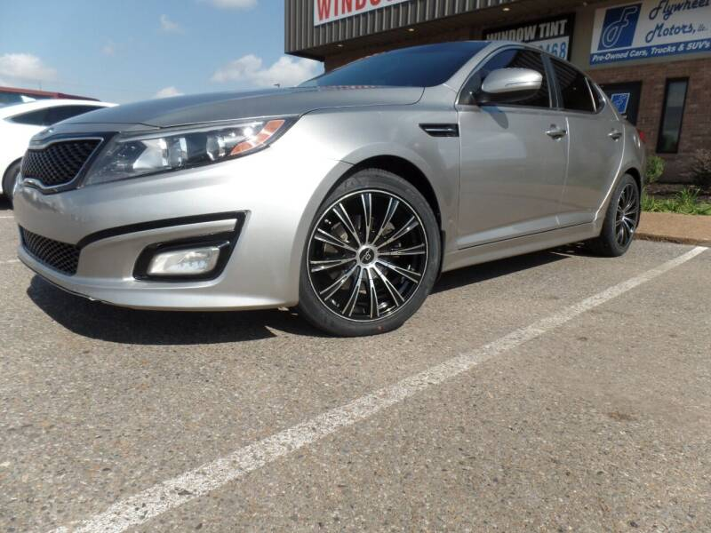 2015 Kia Optima for sale at Flywheel Motors, llc. in Olive Branch MS