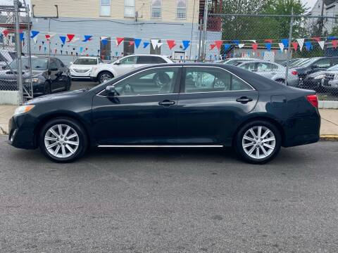 2012 Toyota Camry for sale at G1 Auto Sales in Paterson NJ
