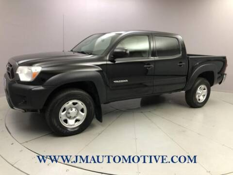 2014 Toyota Tacoma for sale at J & M Automotive in Naugatuck CT