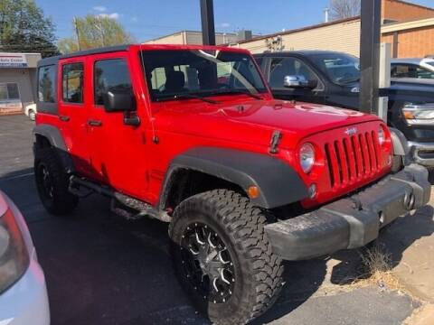 2016 Jeep Wrangler Unlimited for sale at RT Auto Center in Quincy IL