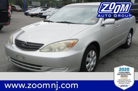2004 Toyota Camry for sale at Zoom Auto Group in Parsippany NJ