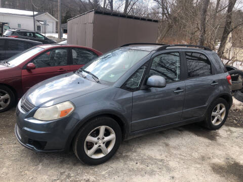 2009 Suzuki SX4 Crossover for sale at Edward's Motors in Scott Township PA