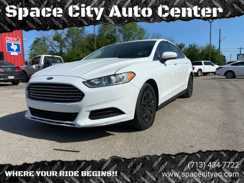 2014 Ford Fusion for sale at Space City Auto Center in Houston TX