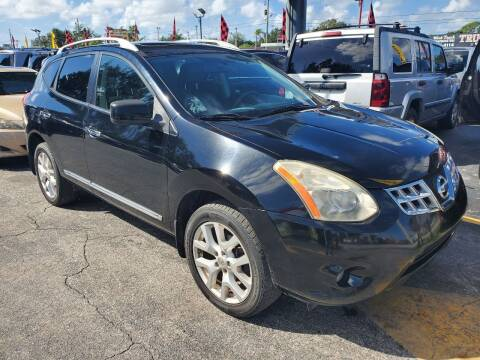 2011 Nissan Rogue for sale at America Auto Wholesale Inc in Miami FL