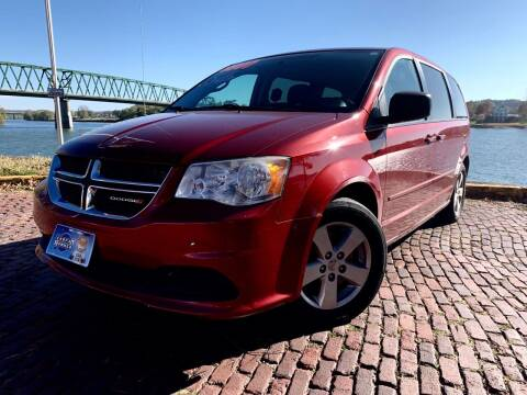 2014 Dodge Grand Caravan for sale at PUTNAM AUTO SALES INC in Marietta OH