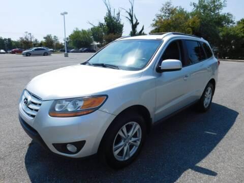2011 Hyundai Santa Fe for sale at AMERICAR INC in Laurel MD