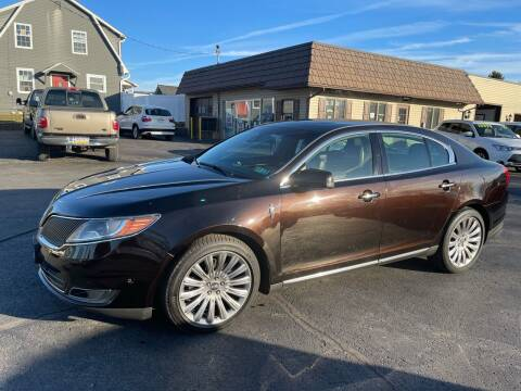 2013 Lincoln MKS for sale at MAGNUM MOTORS in Reedsville PA