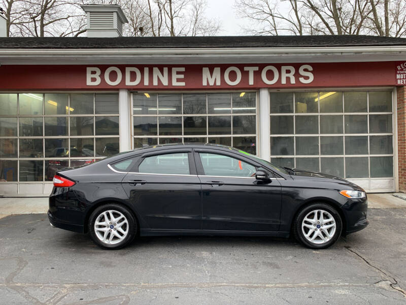 2014 Ford Fusion for sale at BODINE MOTORS in Waverly NY