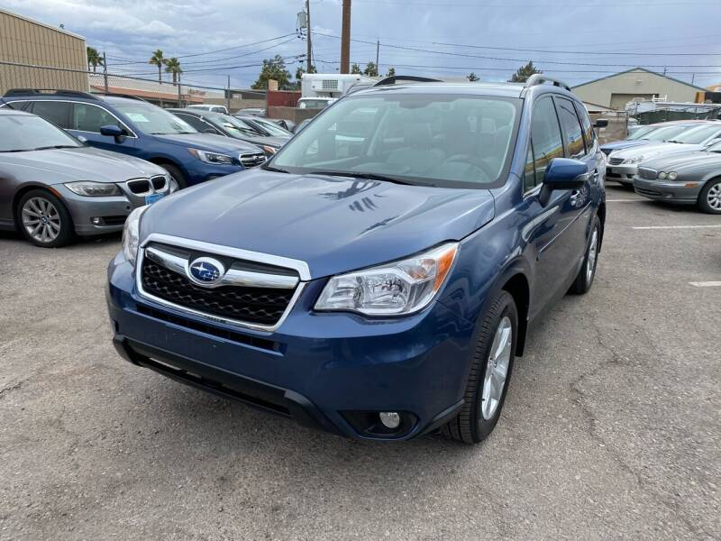 2014 Subaru Forester for sale at CONTRACT AUTOMOTIVE in Las Vegas NV