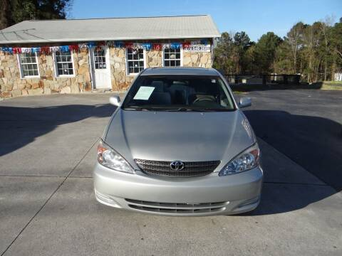 2004 Toyota Camry for sale at Flywheel Auto Sales Inc in Woodstock GA