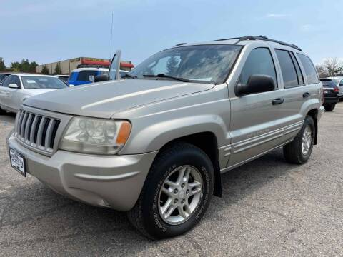 2004 Jeep Grand Cherokee for sale at BERKENKOTTER MOTORS in Brighton CO