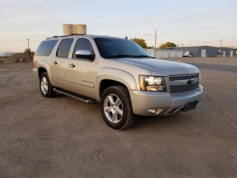2008 Chevrolet Suburban for sale at KHAN'S AUTO LLC in Worland WY