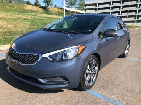 2014 Kia Forte for sale at DRIVE N BUY AUTO SALES in Ogden UT