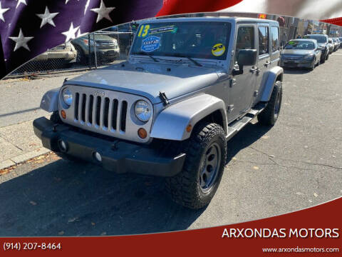 2013 Jeep Wrangler Unlimited for sale at ARXONDAS MOTORS in Yonkers NY