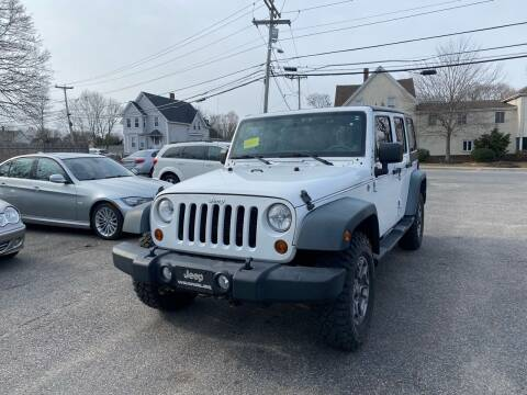 2012 Jeep Wrangler Unlimited for sale at Auto Gallery in Taunton MA