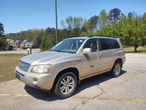 2006 Toyota Highlander Hybrid for sale at WIGGLES AUTO SALES INC in Mableton GA