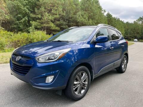 2014 Hyundai Tucson for sale at Carrera AutoHaus Inc in Clayton NC