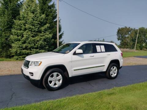 2013 Jeep Grand Cherokee for sale at Carmart Auto Sales Inc in Schoolcraft MI