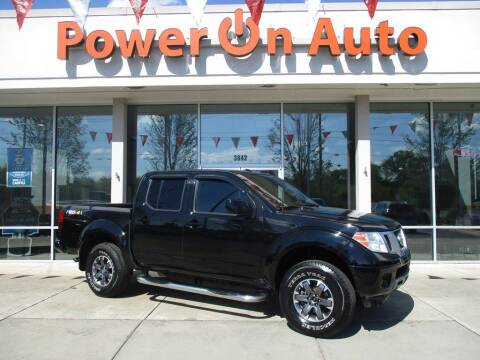 2014 Nissan Frontier for sale at Power On Auto LLC in Monroe NC
