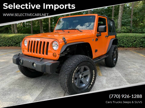 2012 Jeep Wrangler for sale at Selective Imports in Woodstock GA