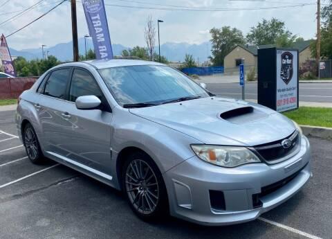 2013 Subaru Impreza for sale at The Car-Mart in Murray UT