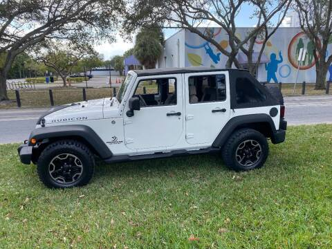 2009 Jeep Wrangler Unlimited for sale at BIG BOY DIESELS in Ft Lauderdale FL