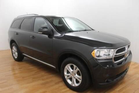2011 Dodge Durango for sale at Paris Motors Inc in Grand Rapids MI