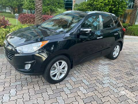 2013 Hyundai Tucson for sale at CYBER CAR STORE in Tampa FL