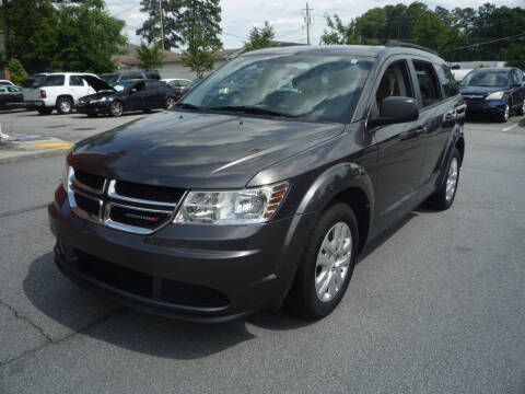2014 Dodge Journey for sale at Credit Cars LLC in Lawrenceville GA
