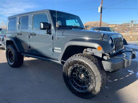 2017 Jeep Wrangler Unlimited for sale at BERKENKOTTER MOTORS in Brighton CO
