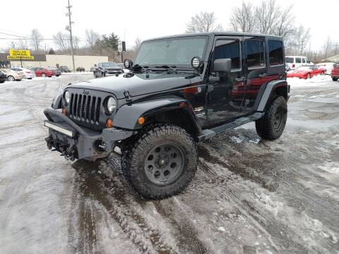 2012 Jeep Wrangler Unlimited for sale at Cruisin' Auto Sales in Madison IN
