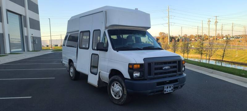 2013 Ford E-Series Cargo for sale at BOOST MOTORS LLC in Sterling VA