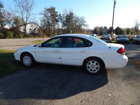 2005 Ford Taurus for sale at PARAGON AUTO SALES in Portage MI
