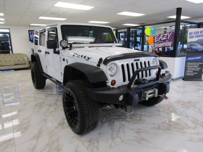 2013 Jeep Wrangler Unlimited for sale at Dealer One Auto Credit in Oklahoma City OK