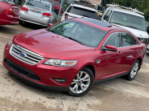 2012 Ford Taurus for sale at Exclusive Auto Group in Cleveland OH