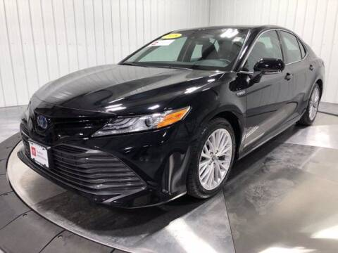 2018 Toyota Camry Hybrid for sale at HILAND TOYOTA in Moline IL