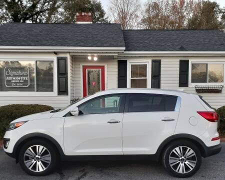 2015 Kia Sportage for sale at SIGNATURES AUTOMOTIVE GROUP LLC in Spartanburg SC