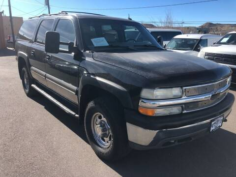 2002 Chevrolet Suburban for sale at BERKENKOTTER MOTORS in Brighton CO
