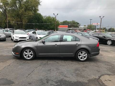 2012 Ford Fusion for sale at Car Zone in Otsego MI