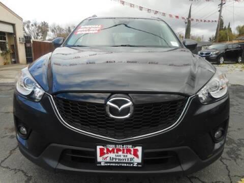 2014 Mazda CX-5 for sale at Empire Auto Sales in Modesto CA