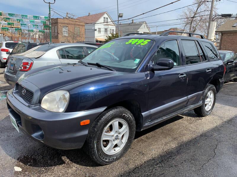 2004 Hyundai Santa Fe for sale at Barnes Auto Group in Chicago IL