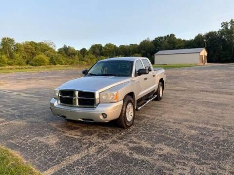 2007 Dodge Dakota for sale at Caruzin Motors in Flint MI