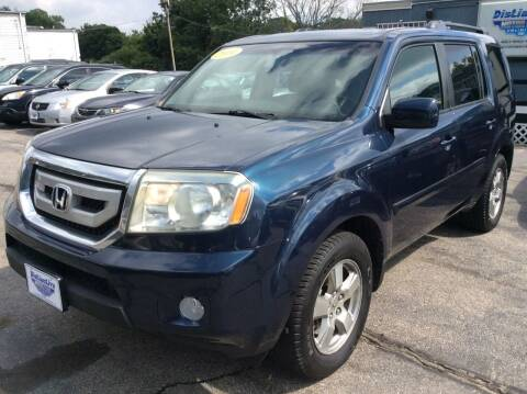 2009 Honda Pilot for sale at DISTINCTIVE MOTOR CARS UNLIMITED in Johnston RI