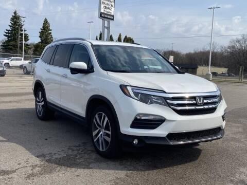 2018 Honda Pilot for sale at Betten Baker Preowned Center in Twin Lake MI