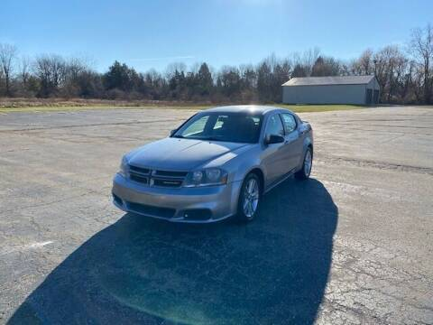 2014 Dodge Avenger for sale at Caruzin Motors in Flint MI