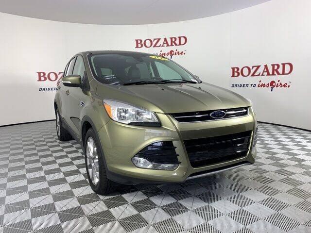 2013 Ford Escape for sale at BOZARD FORD in Saint Augustine FL