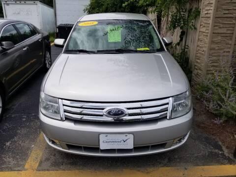 2008 Ford Taurus for sale at Howe's Auto Sales in Lowell MA