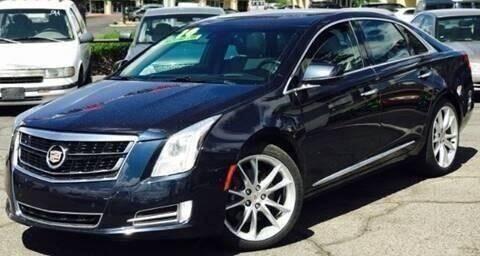 2014 Cadillac XTS for sale at ALBUQUERQUE AUTO OUTLET in Albuquerque NM